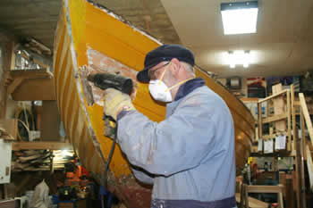 The owner comes over  periodically to do some work, here he is the removing all the hull paint so we  can asses the boat and give her new paint job that will make her look brand  new